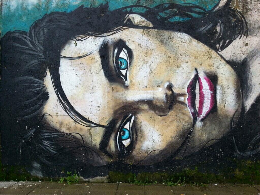Girl with blue eyes street art