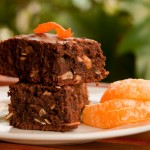Photo of brownie and orange on the plate