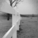 White fence blurred photo