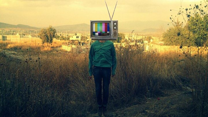 Man in green sweater with old tv instead of head