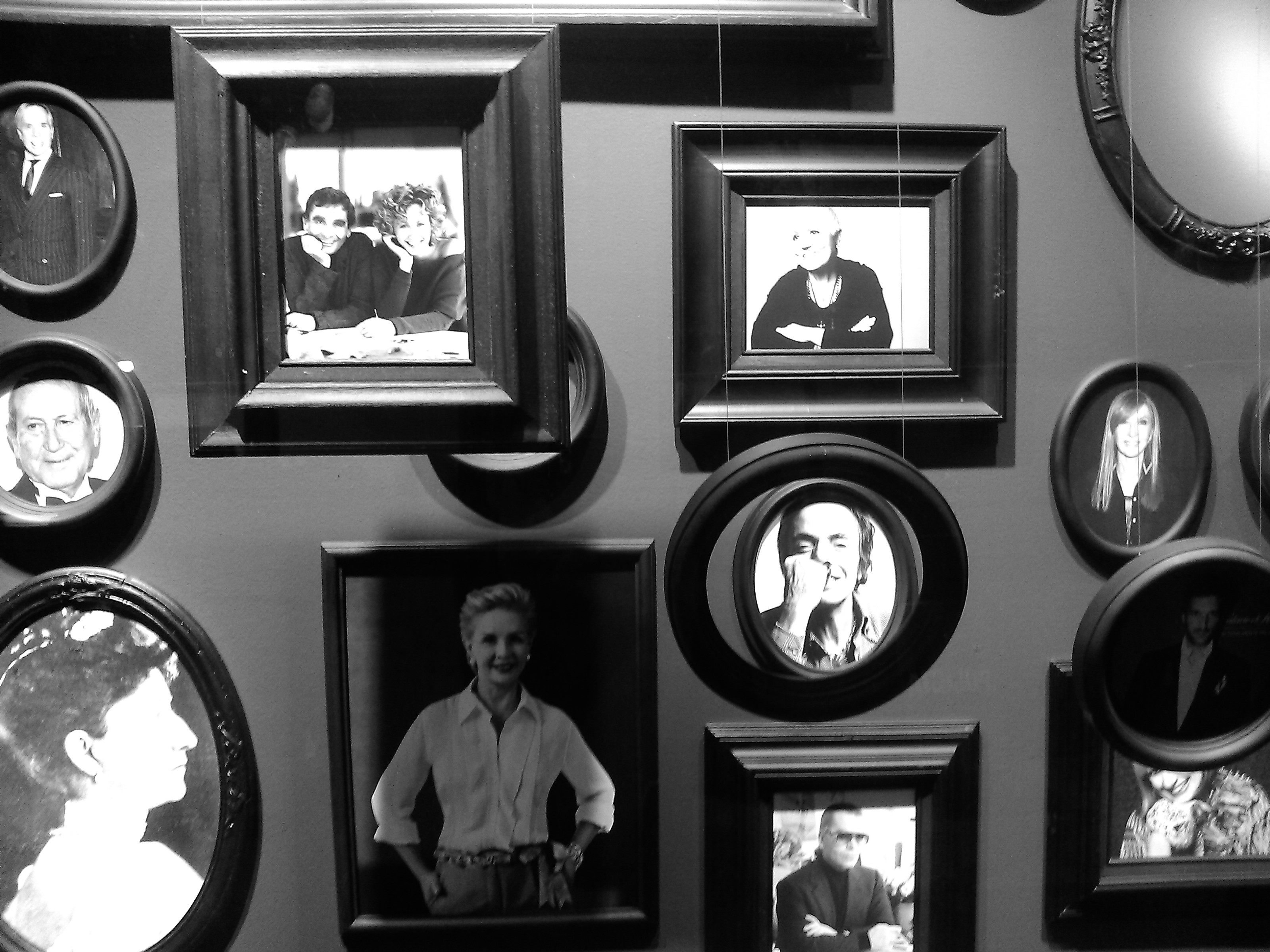 Black and white photo of a wall with pictures