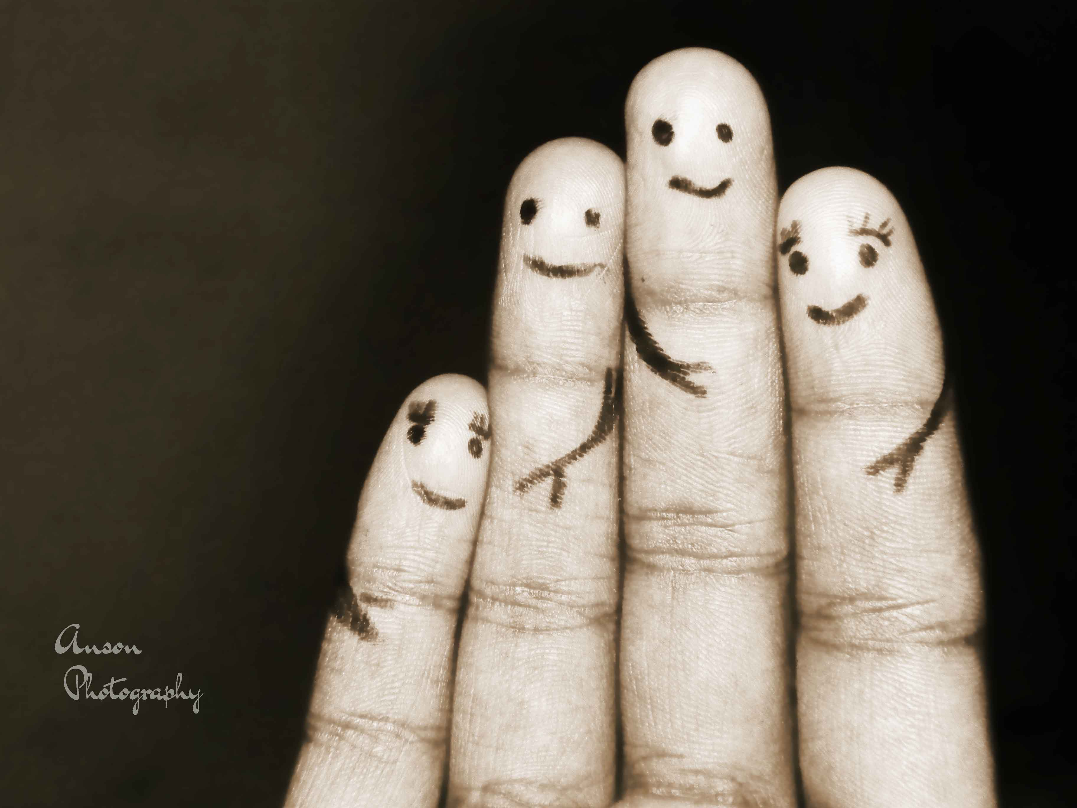 Photo of fingers with faces