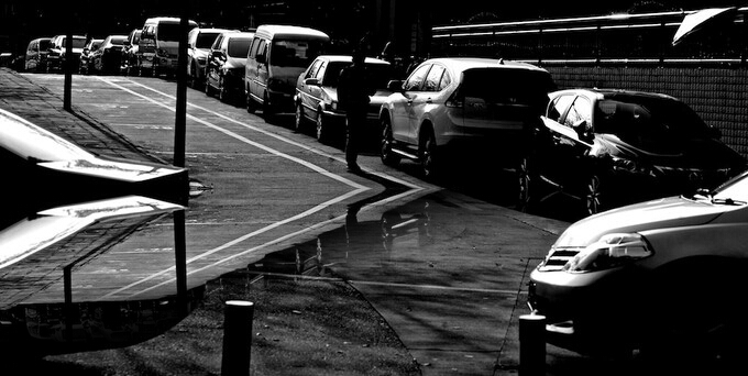 Black and white photo of the street with cars