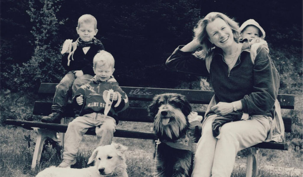 Black and white family photo with dogs