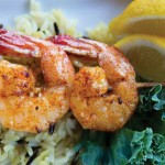 Grilled shrimps on the stick with rice and lemon