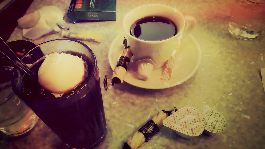 Coffee, candies and cigarettes on the table