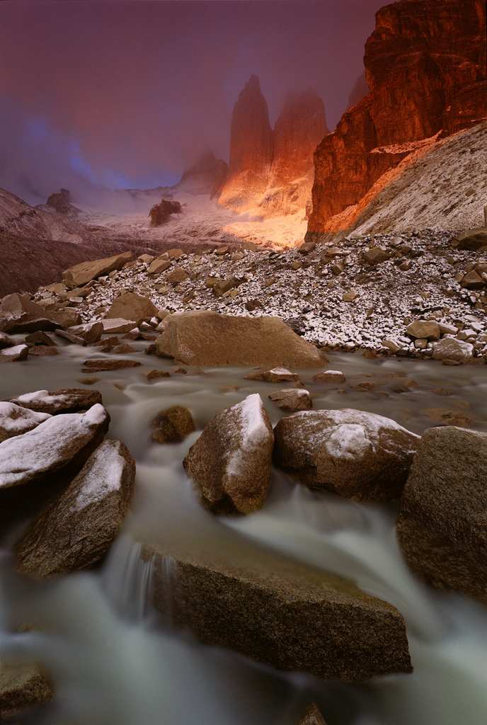 Landscape photo of rocks and fog by Hans Strand