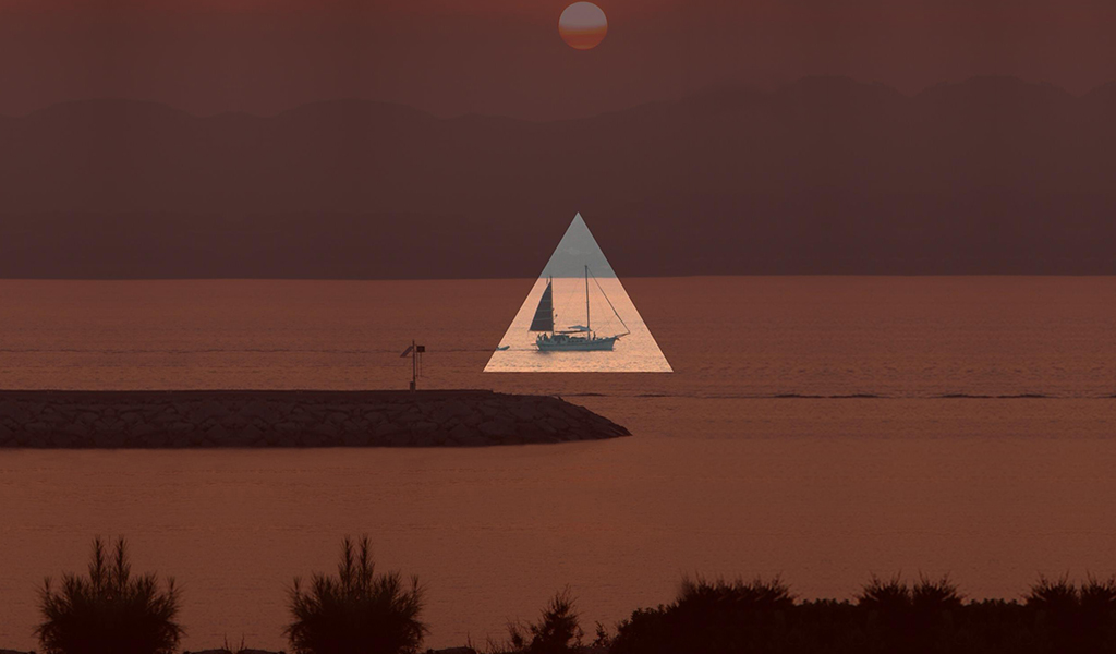 Yacht on the water photo edited with triangle shape mask