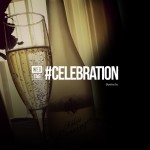 Photo of a wineglass with champagne with celebration text on it