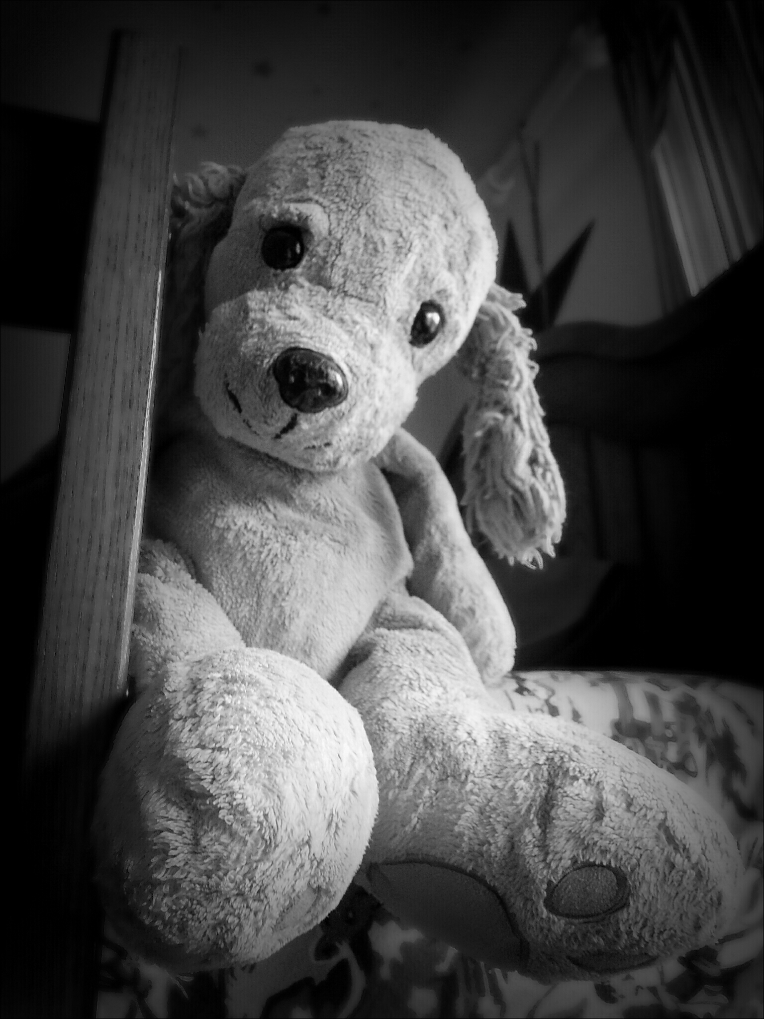 Black and white photo of a big puppy toy