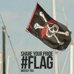 Pirate flag photo with share your pride flag text on it
