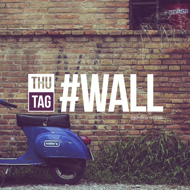 brick wall with hashtag wall and blue moto