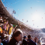 people celebrating at stadium