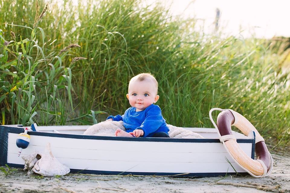 Baby on board with grass background