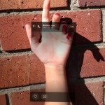 photo of picsart in hand on the bricks background