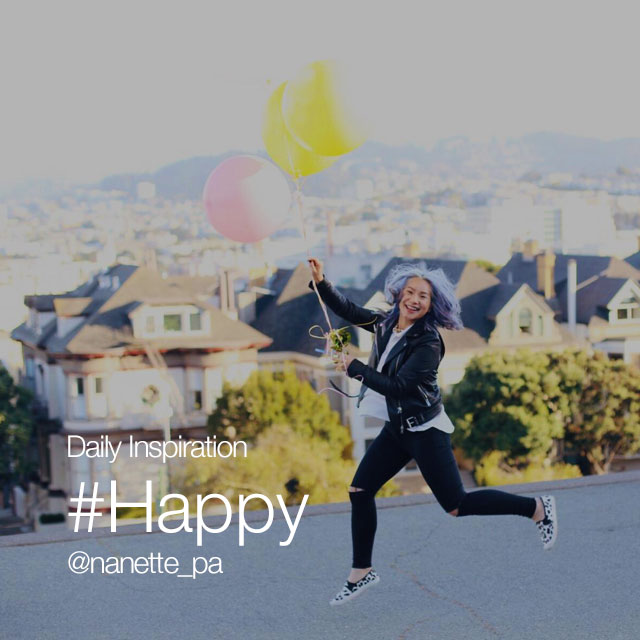 Running happy girl with balloons