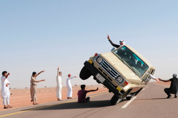 """Youths demonstrate a stunt known as """"sidewall skiing"""" in the northern city of Hail, in Saudi Arabia, March 30, 2013. Photo via REUTERS/Mohamed Al Hwaity."""
