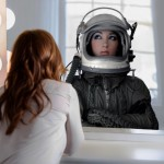 Girl looking at her astronaut mirror reflection