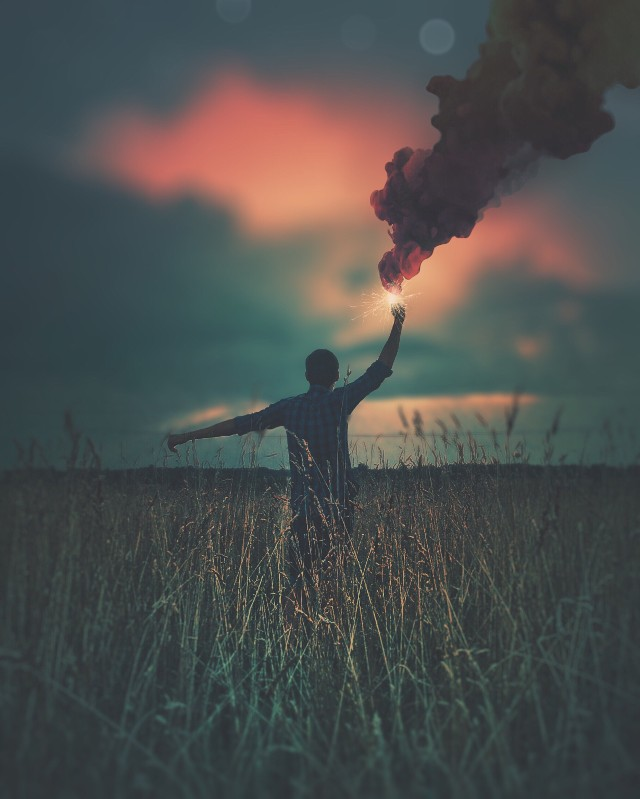 Boy in the field with smoke bomb photography on picsart