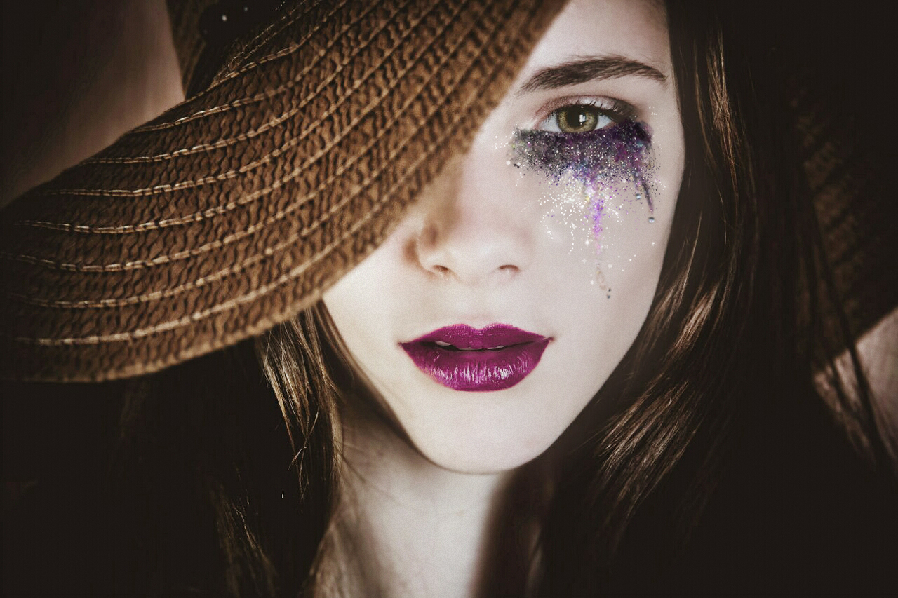Girl in the hat with purple make up