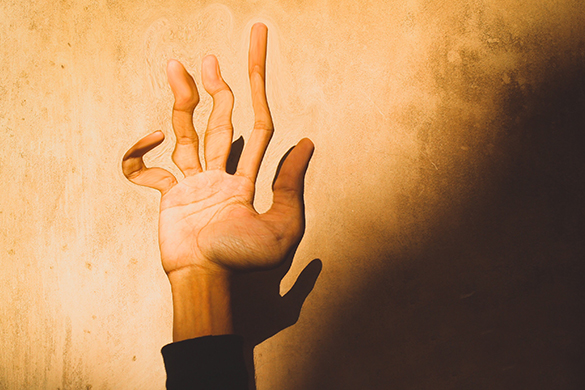 Photo of a hand edited with magic effects
