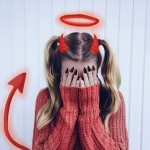 Girl in red sweater using devil stickers