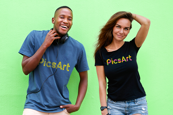 Laughing man and smiling girl wearing picsart tshirts on green background