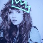 neon outlines crown on the photo of a young woman