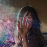 Magic galaxy dust edit on a photo of a young woman