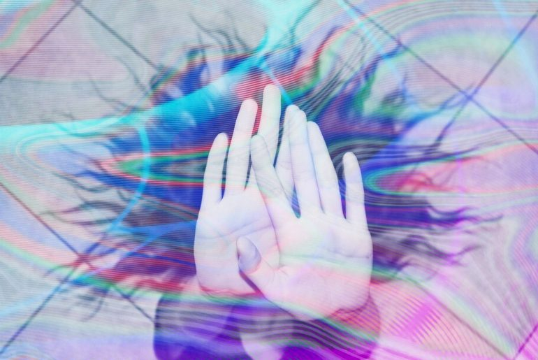 Double Exposure on the photo of a girl hiding her face with hands