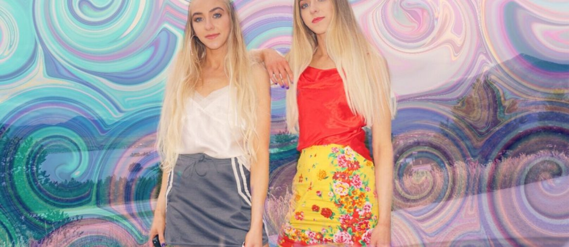two blonde girls with swirl sticker background