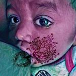 a baby with tree of life effect