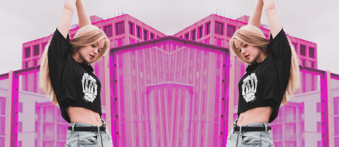 a blonde girl posing with fuchsia backdrop and mirror effect