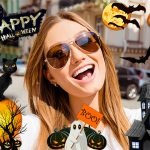 a selfie of a smiling girl edited with halloween stickers