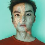 map double exposure effect added to the face of an asian guy