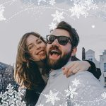 Selfie of a happy couple with snowflake stickers