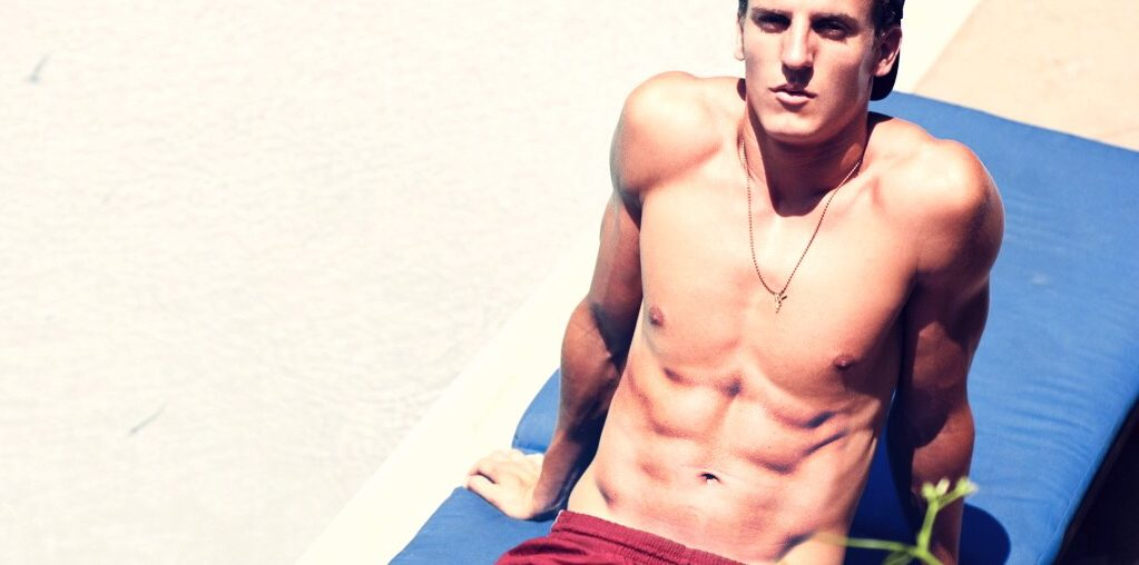 Photo of a man with abs in the sun