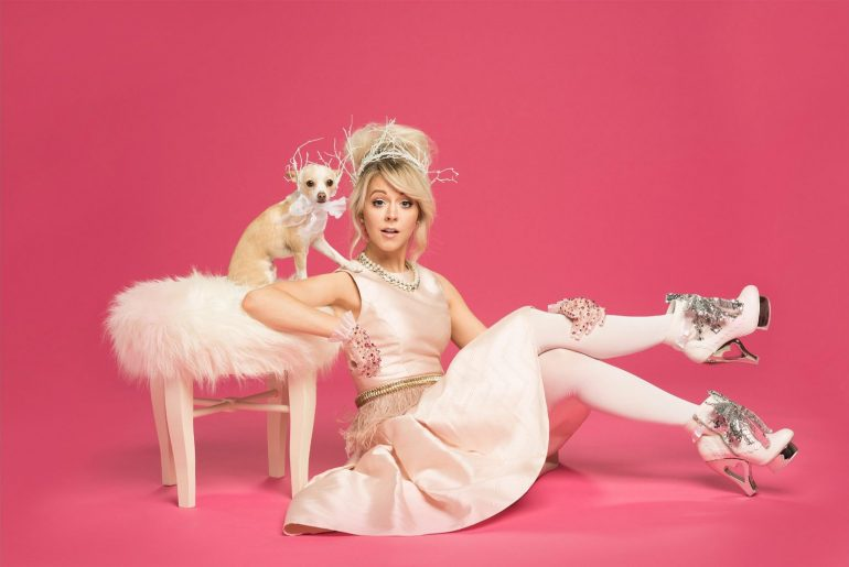 Lindsey Stirling Christmas photo with chihuahua and pink background
