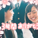 2 Asian smiling girls with pink flower stickers