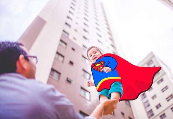 Superman edit on the photo of a smiling baby