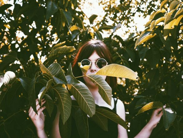 Girl with sunglasses behind the leaves edited with FLTRs