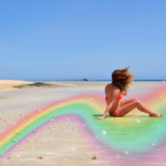 Girl in bikini on the beach using New Summer packs for Gold Subscribers