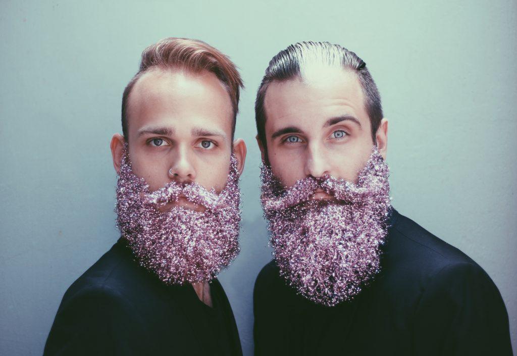 Glitter beard on two men
