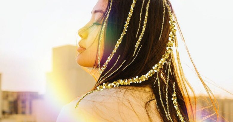 Photo of a girl with gold glitter brush