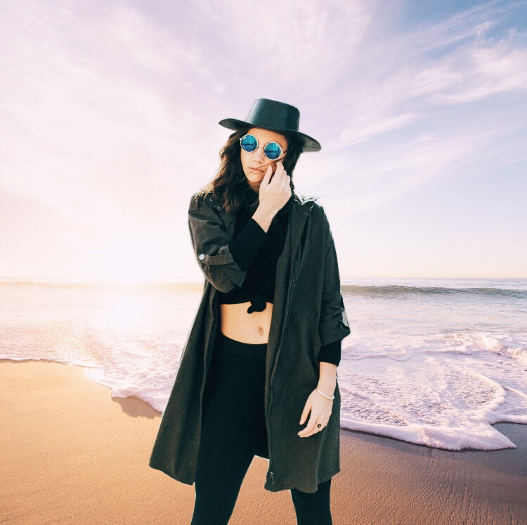 Portrait of fashionable girl at the beach