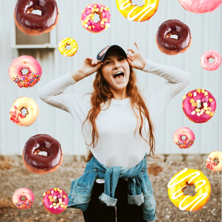 Donut stickers raining from the sky on cheerful girl