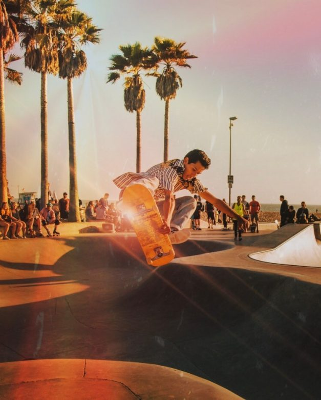Summer photo edit of young skateboarder in southern california