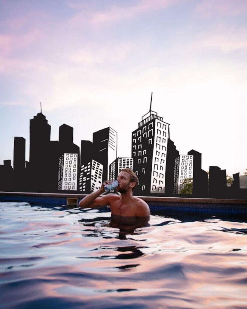 Cityscape edit of man drinking
