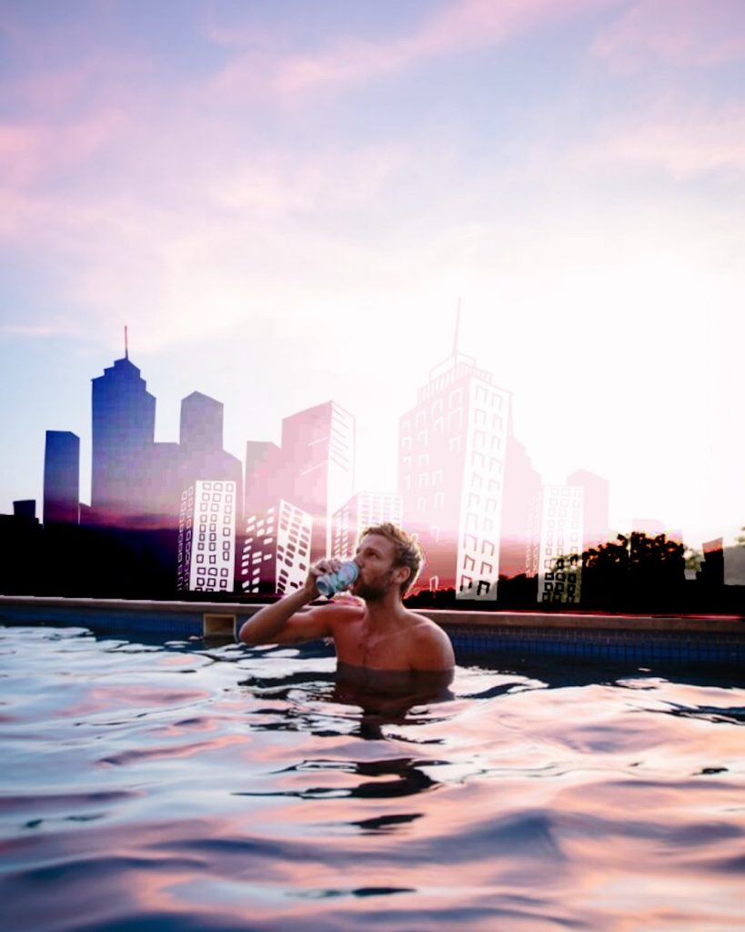 Cityscape edit on the photo of a man drinking