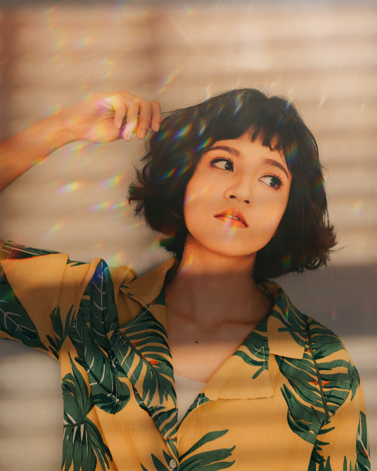 short and black hair girl with yellow shirt photo prism mask effect applied
